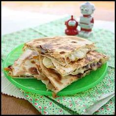 Bean and Vegie Quesadillas     1 tablespoon olive oil  1 brown onion, finely diced  2 garlic cloves, crushed  1 large carrot, peeled, grated  ½ capsicum, seeded, finely chopped (any colour)  2 tomatoes, chopped  400g can red kidney beans, rinsed, drained, roughly mashed ½ tsp sugar ½ tsp ground cumin  1 tbsp barbecue sauce  10 bought tortillas  Grated cheese  Sliced avocado (optional)