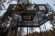 This cabin is like a modern treehouse, where you're in an elevated, all-glass space. Located in Sweden, it has a neutral Nordic interior.