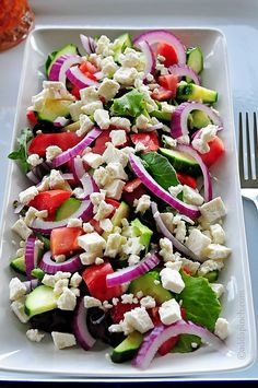 Mediterranean Salad: Full of juicy tomatoes, crisp cucumbers, Feta cheese, slivers of purple onion all on a bed of spring salad greens. Then drizzled it with sundried tomato vinaigrette dressing. Deeeeeee-licious! @addapinch | Robyn Stone