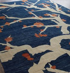 Love this Horchow Branches rug because of its simple, clean, nature-influenced design, the weathered look of the dye, and the combination of navy and orange (reminds me of my alma mater U.Va. Wahoowa!)