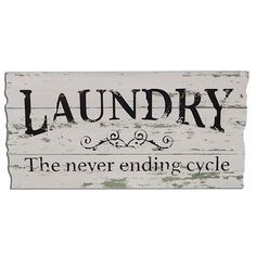 "Neverending Cycle Sign is made of painted, faux-distressed wood and measures 11½"" high by 23"" wide."