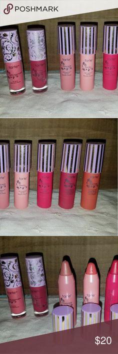 Tarte 5 LipSurgence lip tints & 2 lip glosses All travel size.  Lip gloss, 1.5 ml/. 05 fl oz: 1 in Kiss, new.  1 in Belle, used a few times.  2 matte lip tints, 1.75 g/. 06 oz: shades Eternal (new) & Fancy (used 1x) 3 lip tints, 1.75 g/. 06oz: shades Dainty (used 1x), Dreamy (new) & Innocent (new). tarte Makeup Lip Balm & Gloss