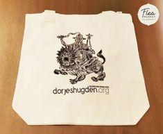 White tote bag featuring a unique image of Dorje Shugden. This is specially designed for those who wish to bring Dorje Shugden's blessings with them wherever they go. It is also great as a gift.