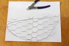Use the snips and cut about 1/2 inch around your drawn lines.