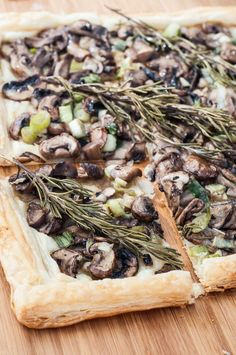 Quick, Easy and Healthy Rosemary Mushroom Tart Recipe! This Vegan Mushroom Tart is so flavorful and simple to make. Eat it as a side, entree, or cut it into small slices for the perfect appetizer! Vegan, and gluten-free if gf puff pastry is used. | VeganFamilyRecipes.com | #vegetarian #dinner #food