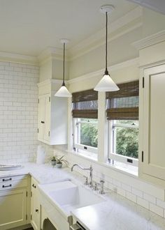 Nice subway tile and granite counters, the farmhouse sinks are awesome! Would want a musky blue for the cabinets.