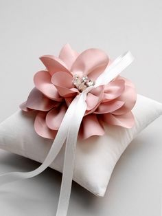 A lovely pink rose inspired wedding ring pillow. By Louloudimeli.