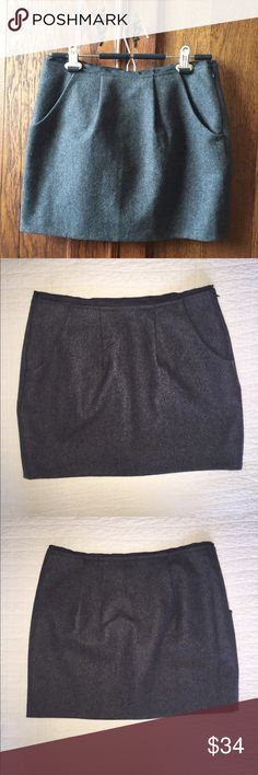 """J CREW charcoal gray wool blend mini skirt HOT!  Cooler weather is coming! Grab this workhorse wool blend mini before someone else does!! From J Crew, it is charcoal gray with understated pleats front and back, 2 front pockets, and hidden left side zip. Flat measurements are approximately: 15"""" waist, 18"""" hips, 14.5"""" length. J. Crew Skirts Mini"""