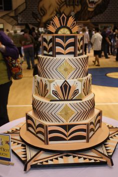 I like how the 2nd and 4th layer are simpler and similar to keep the cake from being too busy and tying the non-matching layers together - images of capital area cake show wedding cakes | Capital Area Cake Show 2013 Wedding Cakes