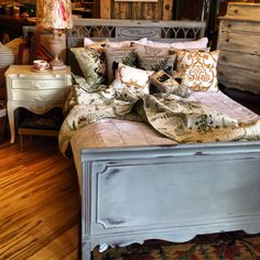 Vintage full size bed in Chalk Paint® by Annie Sloan custom color: mixture of French Linen & Paris Grey.  Painted by Edwin Loy Home.