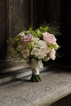 Pink roses, spray roses, sweet peas and fountain grass