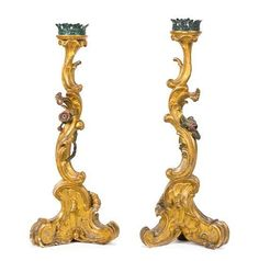 A Pair of Italian Rococo Carved and Parcel Gilt Candlesticks Height 28 3/4 inches. - Price Estimate: $800 - $1200
