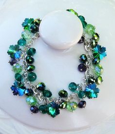 Designed by Cherie: --Beautiful crystal bracelet. The multi-color snowflakes are silver color on the back, which give the colors more depth.  SOLD