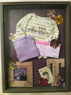 Baby memorabilia shadow box. I Love this, you can put everything from the hospital inside and hang it in the room.