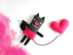 broche de gato con corazón