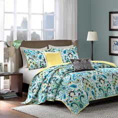 Add a splash of color to your space with the Madison Park Caprice Coverlet Set. This overscaled paisley motif features fresh shades of yellow, teal, green, and black for a fun, modern update. Printed on polyester microfiber, this beautiful coverlet uses 5 oz poly fill and self quilting giving you the option to use this as a decorative piece over your current bedding or can make a statement all on its own. Two decorative pillows feature intricate piecing and embroidery details.