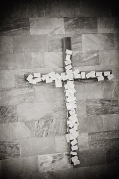 Wedding guests can write a bible verse, words of wisdom, etc. and pin it to the cross.
