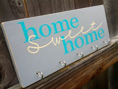 Home Sweet Home key holder wood sign - beige/ice blue. $15.00, via Etsy.  This would be nice by the front door for our keys and stuff.