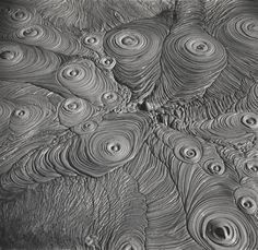 Theo Schoon - Geothermal Study No. 6, c. 1950. Decontextualising geothermal mud pools from their surroundings, Schoon is able to draw an abstract beauty and symmetry out of unique but natural phenomena found in Rotorua,  New Zealand.
