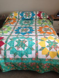 Queen size Swoon quilt using Lark by Amy Butler as the main fabric
