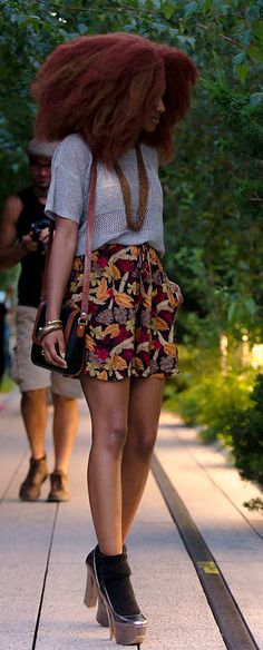 Voluminous patterned shorts and a tucked in short-sleeved sweater. All the yes.