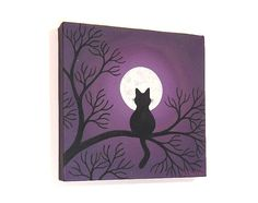 Black cat sitting in a tree, looking up at the full moon on a purple starry night