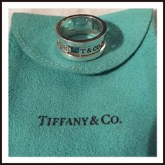 Tiffany & Co. Atlas Ring % authentic Tiffany Atlas Ring, size 5, Sterling Silver!  No low Ball offers I won't respond!!  I've worn it a couple of times, pouch comes with it.  No box or receipt. NOT A BUNDLE PRICE Tiffany & Co. Jewelry Rings