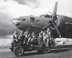 "Air crew posing on Jeep in front of B-17F ""Our Gang"" of 324th BS, 91st BG, US 8th Air Force, Bassingbourn, England, UK, 15 Jun 1943"