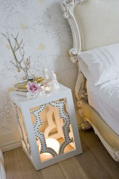 Bedside table with a touch lamp in the base for low lighting... Very pretty bird cage wallpaper also!