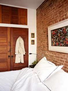 Exposed brick and reclaimed/antique doors; A Perfumer and Teacher's 1900s Brownstone in Harlem | Design*Sponge
