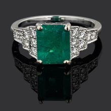 AUD $7,990.00  Product Code: BC20104771 NO1459/2  18ct White Gold Emerald & Diamond Ring. This ring is set with a 1930's emerald cut, Emerald in a four claw setting allowing light to flow through the stone, showing it off to the best of it's ability. The setting is in 18ct white gold, & is in an Art Deco style. The ring has three tappered steps of Diamonds on each shoulder. Dias=0.35cts, G/SI quality. The ring is a beautiful vibrant colour and the setting is classic and elegant.