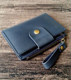 Mens leather key case made of genuine leather, handmade production. Available in 4 colors (brown, dark blue, green and red). This mens key wallet combines quality and know-how. Worldwide shipping from France. Leather Key Case, Leather Wallet, Lighter Case, Key Wallet, Navy Color, Leather Accessories, Leather Craft, Tan Leather, Sewing