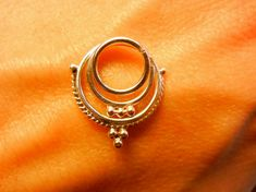 Hey, I found this really awesome Etsy listing at https://www.etsy.com/listing/113778865/trimurti-a-septum-ring-layered-septum