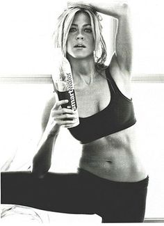 Jennifer Aniston in a black cropped top and leggings.. MAJOR THINspiration