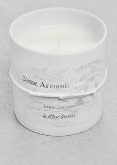 & Other Stories | 'Scented Candle - 2ème Arrondissement'. The magic of deep blooming rose tells the story of our Paris Atelier.  '2éme Arrondissement' is named after the district with the same name that is home to our Paris Atelier, and a constant source of inspiration.
