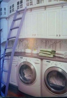 "Love this use of space in a laundry room from ""This Old House"". I think the ladder would hit the opposite wall in mine."