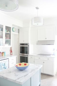 FORMICA MARBLE COUNTERTOPS LOOK LIKE REAL MARBLE! Get the Ideal or Armore edge to eliminate the seam on sides/corners. Also love that the white painted cabinets blend well with the white bulkhead.  painting them the same color here worked really well. http://www.hartson-kennedy.com/edge_profiles_specifications_2_e.html