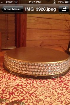 DIY rhinestone cake stand ::My friend and i seen a rhinestone cake stand at craft store for sixty dollars .we put out heads together and come up with this , Cake pan turned upside down painted gold and added rhinestones to it. Way less and she did an awesome job way to go SK