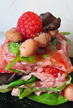 Carpaccio salad with fresh raspberries and baked beans