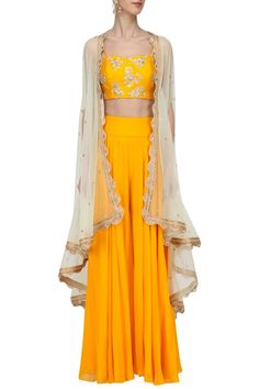 Megha & Jigar presents Mustard embroidered bustier and sharara set with Mint cape available only at Pernia's Pop Up Shop. Indian Attire, Indian Wear, Indian Designer Outfits, Designer Dresses, Indian Dresses, Indian Outfits, Beige Crop Tops, Drape Pants, Mehndi Outfit
