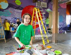 Stock Photo : Students painting mural in studio
