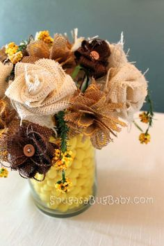 Burlap flowers.  La Belle Bride has a video tutorial as below if you need a little more than this tutorial.   http://www.labellebride.com/2011/03/04/diy-burlap-flower-rad-and-rustic/