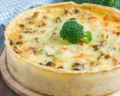 Quiche légère poulet, champignons et brocoli : http://www.fourchette-et-bikini.fr/recettes/recettes-minceur/quiche-legere-poulet-champignons-et-brocoli.html