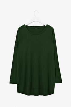 Top with curved hem