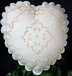 Elegant and romantic. Our Naples pillow is beautifully embellished with hand cutwork embroidered roses and sunflowers. It adds a romantic touch to your bed and sofa. This heart shape pillow is a perfect Ring-Bearer pillow for your wedding. Imported. Sham removable for laundering. Sham: cotton/linen blend.
