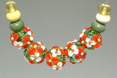 Set of 5 Orange and White Handmade Lampwork Flower Floral Beads. Earth Tones, Springtime Green Glass Beads.. by FlamingGlassHoles on Etsy