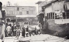 بغداد : رقبة الجسر في الكرخ .. للرحالة السويدي سفين هيدين 1916 يظهر مقهى العكامة على اليمين ... البناية في وسط الصورة هي ساحة الشهداء اليوم