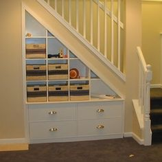Built in storage under the stairs is a brilliant idea!