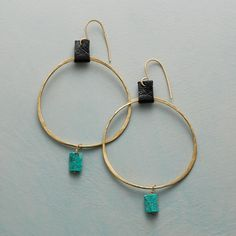 """TAMSIN HOOP EARRINGS- $230.00 -Suspended from soft deerskin tabs, hammered brass hoops get a bit of color with 14kt gold wire-wrapped pins holding turquoise nuggets. By Renee Garvey. 10kt gold wires. USA. 2-3/8""""L."""