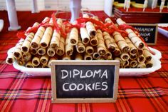 Graduation Party - super easy diploma cookies!  Store bought pirouette rolled wafer cookies just add ribbon!